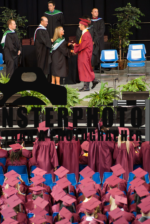 06/13/12 Newark DE: Appoquinimink seniors receive there diplomas during Appoquinimink graduation ceremony Wednesday, June 13. 2012, at The Bob Carpenter Center in Newark Delaware...Special to The News Journal/SAQUAN STIMPSON