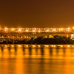 Panoramic picture of Cincinnati John A. Roebling bridge at night. Roebling Bridge is a suspension bridge that connects Cincinnati Ohio and Covington Kentucky over the Ohio River. Panorama photo ratio is 1:3.