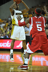 Jan 23, 2010; Columbia, MO, USA; Missouri Tigers guard Miguel Paul (3) goes up for a shot as Nebraska Cornhuskers guard Sek Henry (5) attempts to block in the second half at Mizzou Arena in Columbia, MO. Missouri won 70-53. Mandatory Credit: Denny Medley-US PRESSWIRE