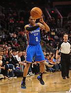Feb. 4, 2011; Phoenix, AZ, USA; Oklahoma City Thunder guard Russell Westbrook (0) makes a pass against the Phoenix Suns at the US Airways Center. Mandatory Credit: Jennifer Stewart-US PRESSWIRE