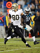 New Orleans Saints tight end Jimmy Graham (80) is double covered by Carolina Panthers middle linebacker Luke Kuechly (59) and Carolina Panthers outside linebacker Thomas Davis (58) as he goes out for a pass during the NFL week 9 regular season football game against the Carolina Panthers on Thursday, Oct. 30, 2014 in Charlotte, N.C. The Saints won the game 28-10. ©Paul Anthony Spinelli