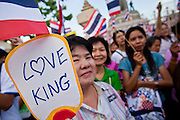 "Apr. 18, 2010 - Bangkok, Thailand: A Pink Shirt holds up placard supporting Thai King Bhumibol Adulyadej during a peace rally Sunday. Thousands of so called ""Pink Shirts"" jammed the area around Victory Monument in Bangkok to show support the Thai Monarch, King Bhumibol Adulyadej, and against the Red Shirts, who are demonstrating just a few kilometres away in the Ratchaprasong area. The Pink Shirts claim to not support either of the other political factions who wear colors - the Red Shirts, who support deposed Prime Minister Thaksin Shinawatra and their opponents the Yellow Shirts, who are against Thaksin.    Photo By Jack Kurtz"