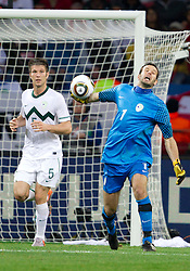 Bostjan Cesar of Slovenia and Goalkeeper of Slovenia Samir Handanovic during the 2010 FIFA World Cup South Africa Group C Third Round match between Slovenia and England on June 23, 2010 at Nelson Mandela Bay Stadium, Port Elizabeth, South Africa. England defeated Slovenia 1-0 and qualified for the next round, Slovenia not. (Photo by Vid Ponikvar / Sportida)