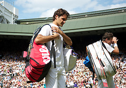 LONDON, ENGLAND - Wednesday, June 30, 2010: Roger Federer (SUI) looks dejected after being beaten by Tomas Berdych (CZE) as they walk off Centre Court the Gentlemen's Singles Quarter-Final on day nine of the Wimbledon Lawn Tennis Championships at the All England Lawn Tennis and Croquet Club. (Pic by David Rawcliffe/Propaganda)