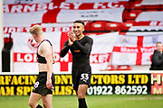 Barnsley forward Jacob Brown (33) celebrates  after the EFL Sky Bet League 1 match between Walsall and Barnsley at the Banks's Stadium, Walsall, England on 23 March 2019.