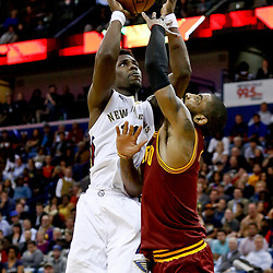Jan 23, 2017; New Orleans, LA, USA; New Orleans Pelicans guard Jrue Holiday (11) shoots over Cleveland Cavaliers guard Kyrie Irving (2) during the second half of a game at the Smoothie King Center. The Pelicans defeated the Cavaliers 124-122. Mandatory Credit: Derick E. Hingle-USA TODAY Sports