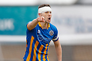 Shrewsbury Town defender Matthew Sadler (5) shouts out instructions during the EFL Sky Bet League 1 match between Shrewsbury Town and AFC Wimbledon at Greenhous Meadow, Shrewsbury, England on 24 March 2018. Picture by Simon Davies.