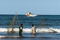 Fishers pulling in a fine mesh gill net along the Malindi coastline, Kenya