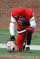 06 December 2014:  Normal Illinois. Oshay Dunmore kneels in prayer before the beginning of the 2nd half during a 1st round FCS NCAA football game between the Panthers of Northern Iowa and the Redbirds of Illinois State in Hancock Stadium.  Illinois State won the game 41-21.