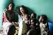 01-20-2005--Ashley Judd, Global Ambassador for YouthAIDS visits a church in Soweto South Africa on January 20, 2005 where she prays with a little boy and his neighbors.  The meeting was facilitated by Population Services International and YouthAIDS and focused on improving health for mothers and their children.  Ashley Judd was named Global Ambassador for YouthAIDS in 2003 and has traveled to Asia, Africa and Latin America to boost the organization's HIV prevention efforts among 15-24 year olds. <br />