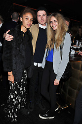 Left to right, ADWOA ABOAH, FELIX COOPER and CARA DELEVINGNE at a party to celebrate 41 years of the Farm Club in Verbier held at Club Nouveau, The Arts Club, Dover Street, London on 16th November 2011.