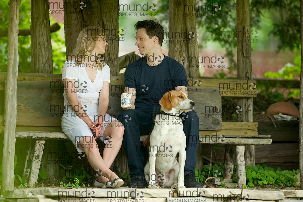 Harrington, Ontario ---16/06/07--- Dayna Tekatch and Laird Mackintosh sit on a bench with their dog Charlie at their home in Harrington near Stratford, Ontario. The couple are actors with the Stratford Festival and are the third group of actors from the festival to own the home..Photo by GEOFF ROBINS for National Post.(For Homes story by Jack Kohane, New Homes).
