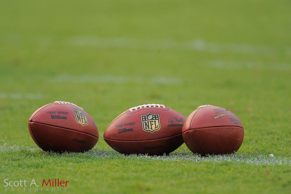 Footballs sit on the field prior to the Miami Dolphins against the Tampa Bay Buccaneers at Raymond James Stadium on Aug. 27, 2011 in Tampa, Fla...(SPECIAL TO FOX SPORTS.COM/Scott A. Miller)