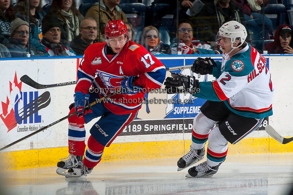 KELOWNA, CANADA - JANUARY 4: James Hilsendager #2 of the Kelowna Rockets checks Kailer Yamamoto #17 of the Spokane Chiefs on January 4, 2017 at Prospera Place in Kelowna, British Columbia, Canada.  (Photo by Marissa Baecker/Shoot the Breeze)  *** Local Caption ***