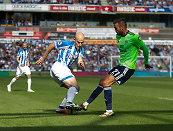 Aaron Mooy of Huddersfield Town (L) and Victor Camarasa of Cardiff City in action - Mandatory by-line: Jack Phillips/JMP - 25/08/2018 - FOOTBALL - The John Smith's Stadium - Huddersfield, England - Huddersfield Town v Cardiff City - English Premier League