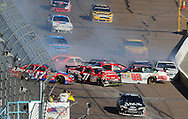 Nov. 15, 2009; Avondale, AZ, USA; NASCAR Sprint Cup Series driver Matt Kenseth (17), Bobby Labonte (71), and Dale Earnhardt Jr. (88) crashes during the Checker O'Reilly Auto Parts 500 at Phoenix International Raceway. Mandatory Credit: Jennifer Stewart-US PRESSWIRE