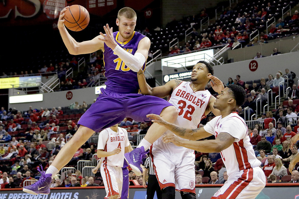 Northern Iowa forward Seth Tuttle (10) pulls in a rebound against Bradley forward Mike Shaw (32) and guard Ka'Darryl Bell (0) during the first half of an NCAA college basketball game at Carver Arena Tuesday, Jan. 13, 2015, in Peoria, Ill. (AP Photo/ Stephen Haas)