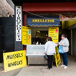 Small seafood kiosk selling shellfish at Barras market in Gallowgate Glasgow, United Kingdom