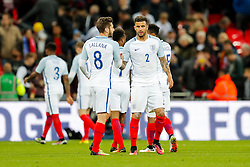 Man of the Match Kyle Walker is congratulated by Adam Lallana of England - Mandatory byline: Rogan Thomson/JMP - 02/06/2016 - FOOTBALL - Wembley Stadium - London, England - England v Portugal - International Friendly.