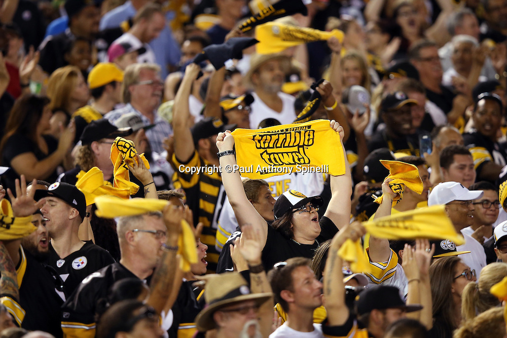 "The stadium crowd has a distinct Pittsburgh Steelers look to it as fans wave ""Terrible Towels"" during the 2015 NFL week 5 regular season football game against the San Diego Chargers on Monday, Oct. 12, 2015 in San Diego. The Steelers won the game 24-20. (©Paul Anthony Spinelli)"