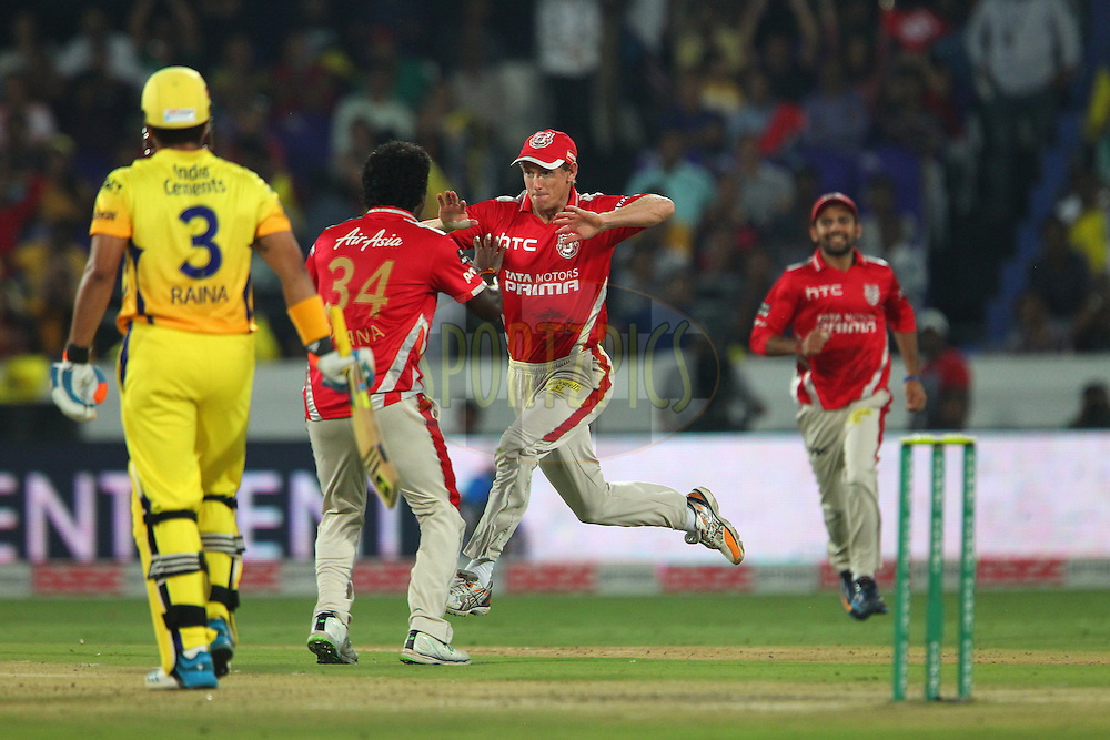 George BAILEY (Captain) of the Kings XI Punjab celebrates the wicket of Suresh RAINA of the Chennai Superkings  during the second semi final match of the Oppo Champions League Twenty20 between the Kings XI Punjab and the Chennai Superkings held at the Rajiv Gandhi Cricket Stadium, Hyderabad, India on the 2nd October 2014<br /> <br /> Photo by:  Ron Gaunt / Sportzpics/ CLT20<br /> <br /> <br /> Image use is subject to the terms and conditions as laid out by the BCCI/ CLT20.  The terms and conditions can be downloaded here:<br /> <br /> http://sportzpics.photoshelter.com/gallery/CLT20-Image-Terms-and-Conditions-2014/G0000IfNJn535VPU/C0000QhhKadWcjYs