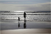 South Africa, Eastern Cape, Amatola Coast, Cinsta West, Buccaneers backpackers, Silhouette of adult and child playing in the breakers, <br /> Photo: &copy; Zute Lightfoot