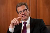 12 JAN 2012, BERLIN/GERMANY:<br /> Guido Westerwelle, FDP, Bundesaussenminister, waehrend einem Interview, Auswaertiges Amt<br /> IMAGE: 20120112-02-032