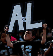 Richie de la Paz 9, holding his tribute to Al Davis before the game. The Oakland Raiders vs the Cleveland Browns in Oakland at the Coliseum, Sunday October 16, 2011.The Oakland Raiders vs the Cleveland Browns in Oakland at the Coliseum, Sunday October 16, 2011.
