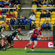 Ardie Savea passes during the Super rugby union game (Round 14) played between Hurricanes v Reds, on 18 May 2018, at Westpac Stadium, Wellington, New  Zealand.    Hurricanes won 38-34.