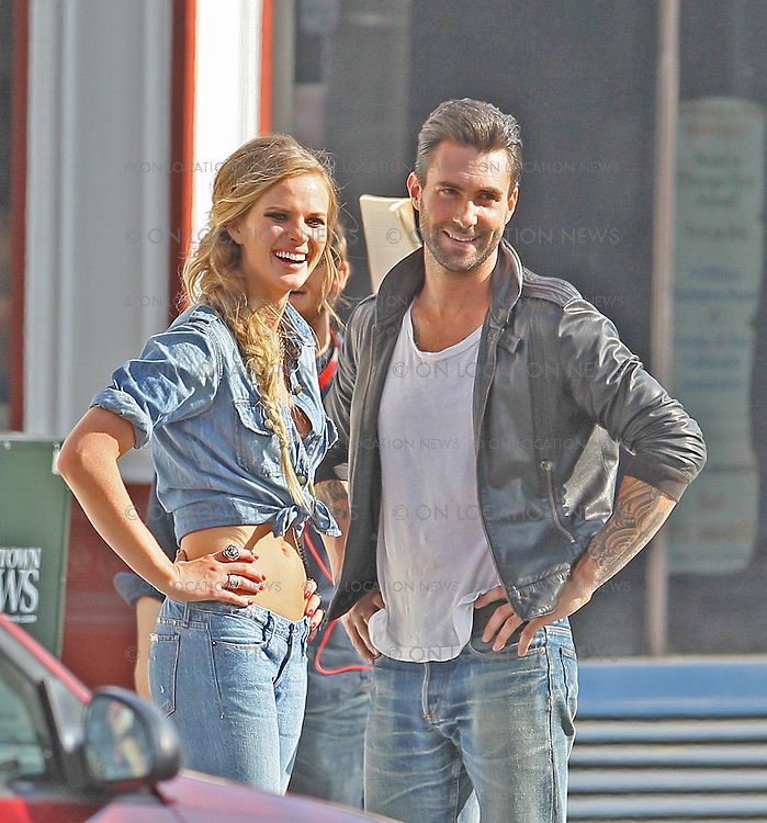 """May 15th 2010. Los Angeles, CA. ***EXCLUSIVE*** Adam Levine with his beautiful Russian Supermodel girlfriend Anne Vyalitsyna  filming a Maroon 5 Music Video for their song; """"Misery"""". The sexy couple filmed various scenes of loving affection with passionate kissing followed by scenes of humorous violence and destruction. In this action packed Music Video, Adam Levine and his band mates are fleeing from Anne Vyalitsyna who is humorously trying to kill them in various ways. Scenes include a missile gun attack and knife throwing from Anne, Adam being hit by a car while running away, Adam being close lined by Anne off a motorcycle that he is fleeing on,  Adam being kicked through a cafe window as well as being ejected from the window of a high rise building. The couple were constantly kissing, hugging and holding hands while on set. They both shared a big luxury trailer while not filming. Photo by Eric Ford/ On Location News. 818-613-3955. info@onlocationnews.com"""