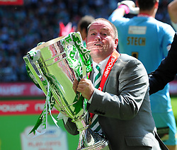 Yeovil Town Manger, Gary Johnson picks up the cup after winning the League 1 Play Off final - Photo mandatory by-line: Dougie Allward/JMP - Tel: Mobile: 07966 386802 19/05/2013 - SPORT - FOOTBALL - LEAGUE 1 - PLAY OFF - FINAL - Wembley Stadium - London - Brentford V Yeovil Town