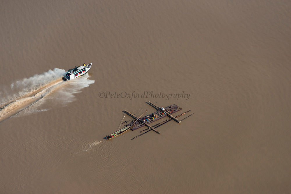 Speed boat & log barge<br /> Essequibo River<br /> GUYANA<br /> South America<br /> Longest river in Guyana