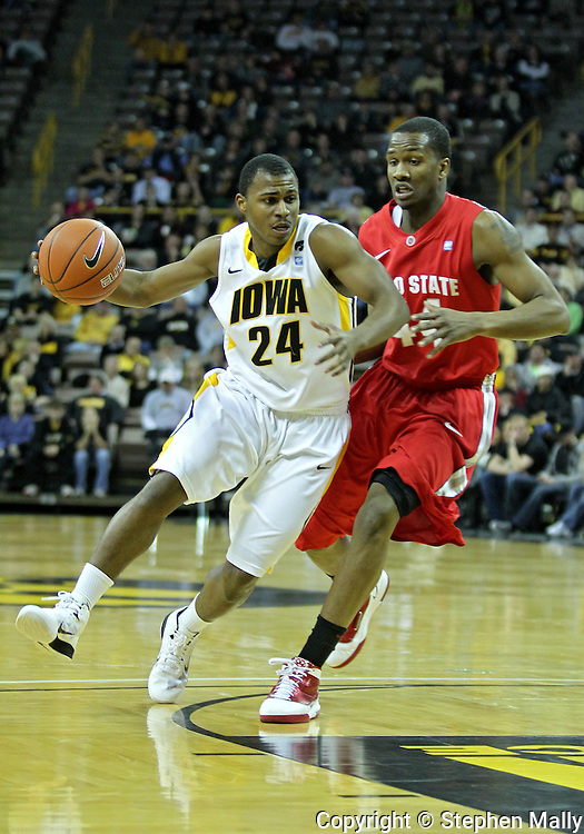 January 04 2010: Iowa Hawkeyes guard Bryce Cartwright (24) drives around Ohio State Buckeyes guard William Buford (44) during the first half of an NCAA college basketball game at Carver-Hawkeye Arena in Iowa City, Iowa on January 04, 2010. Ohio State defeated Iowa 73-68.
