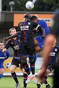 AFC Wimbledon striker Kweshi Appiah (9) battles for possession with Crystal Palace Mamadou Sakho (12) during the Pre-Season Friendly match between AFC Wimbledon and Crystal Palace at the Cherry Red Records Stadium, Kingston, England on 30 July 2019.