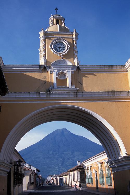 Guatemala, Antigua, Volcan Agua seen through the Arch of Santa Catalina.