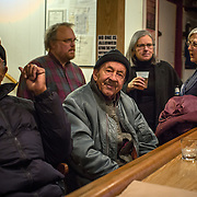 TAKOMA PARK, MD  - JAN 25: Retired navy veteran Rainbow Wilson (c) and retired Army veteran Thomas Sykes (left), socialize at their local VFW which has opened its doors to the public for a concert in Takoma Park, Maryland, January 25, 2014. VFW Posts are dying all across the country but in the unlikely liberal haven of Takoma Park, the old VFW is showing signs of life. By throwing open the doors to private parties and concerts, the club is breaking even in spite of dwindling membership. Several times a month, the bar dwelling regular vets are sharing space with the bureaucrats, activists and peaceniks from the surrounding neighborhood. (Photo by Evelyn Hockstein/For The Washington Post)