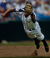 06/18/2006 Georgia Tech's MIke Trapani can't quite catch up with a John Curtis single during game five of the College World Series in Omaha Nebraska Sunday evening. THat broke up a no-hitter in the third inning..(photo by Chris Machian /Prairie Pixel Group)