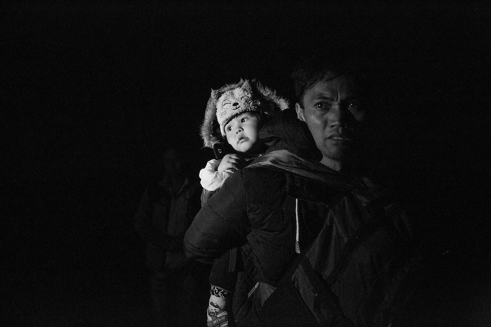 Migrants and refugees arrive on the Greek island of Lesbos after crossing the Aegean Sea from Turkey on November 20, 2015.  European leaders tried to focus on joint action with Africa to tackle the refugee crisis, as Slovenia became the latest EU member to act on its own by barricading its border. (Photo by Lori Hawkins)