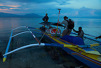 Boarding pumpboat we used to travel from Foli to Labilabi along the Halmahera coast..