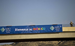 A member of the Mexican Navy guards the surroundings of the International Convention Center of San Jose del Cabo, the venue of the upcoming G20 Summit, in Los Cabos, northwest Mexico, on June 16, 2012. Los Cabos is ready for the arrival of the heads of state and government of the 20 most important economies of the world who will participate in the 7th leaders summit of Group of 20, that will take place on June 18 and 19. Photo By Imago/i-Images