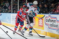 KELOWNA, CANADA - MARCH 5: Matt Sozanski #21 of the Spokane Chiefs checks Tyrell Goulbourne #12 of the Kelowna Rockets as he makes a pass on March 5, 2014 at Prospera Place in Kelowna, British Columbia, Canada.   (Photo by Marissa Baecker/Getty Images)  *** Local Caption *** Matt Sozanski; Tyrell Goulbourne;
