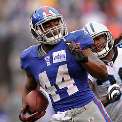 New York Giants running back Ahmad Bradshaw (44) brakes a long run away from Carolina Panthers safety Charles Godfrey (30) during second half NFL action in the New York Giants' 31-18 victory over the Carolina Panthers at New Meadowlands Stadium in East Rutherford, New Jersey.