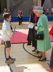 Image ©Licensed to i-Images Picture Agency. 12/06/2014. London, United Kingdom. In the frame - HM Thhe Queen meeting Johan Orly 11yrs who had been taking part in some fencing. <br /> HM The Queen today officially opens the new Westminster School's sports Centre for Westminster School. HM watched an array of sports including judo, fencing cricket and yoga. Picture by  i-Images