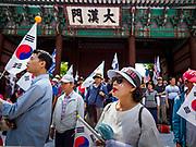 09 JUNE 2018 - SEOUL, SOUTH KOREA: Members of the crowd listen to speakers during a pro-American rally in downtown Seoul. Participants said they wanted to thank the US for supporting South Korea and they hope the US will continue to support South Korea. Many were also opposed to ongoing negotiations with North Korea because they don't think Kim Jong-un can be trusted to denuclearize or to not attack South Korea.    PHOTO BY JACK KURTZ