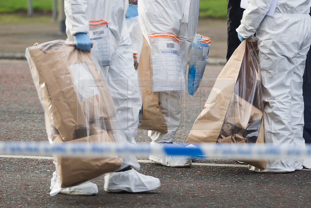 © Licensed to London News Pictures. 11/01/2017. Brighton, UK. Forensic officers carrying evidence bags when they leave the tent that covers the body of a pedestrian who was killed by a car that was being persued by police on Tuesday Evening. The vehicle in question was later found abandoned Madeira Drive. The pedestrian was pronounced dead at the scene. Photo credit: Hugo Michiels/LNP