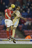 Photo: Aidan Ellis.<br /> Barnsley v Bristol City. Coca Cola League 1. 04/02/2006.<br /> Barnsley's Paul Heckingbottom beats Bristol's Calvin Andrew to the ball