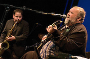 """John Martyn <br /> performing 'Solid Air' live at <br /> The Roundhouse, Chalk Farm, London, Great Britain<br /> February 3rd, 2007<br /> <br /> John Martyn, OBE (11 September 1948 – 29 January 2009), born as Iain David McGeachy, was a British singer-songwriter and guitarist. Over a 40-year career, he released 21 studio albums, working with artists such as Eric Clapton, David Gilmour and Phil Collins. He was described by The Times as """"an electrifying guitarist and singer whose music blurred the boundaries between folk, jazz, rock and blues"""".<br /> <br /> John Martyn <br /> <br /> Photograph by Elliott Franks"""