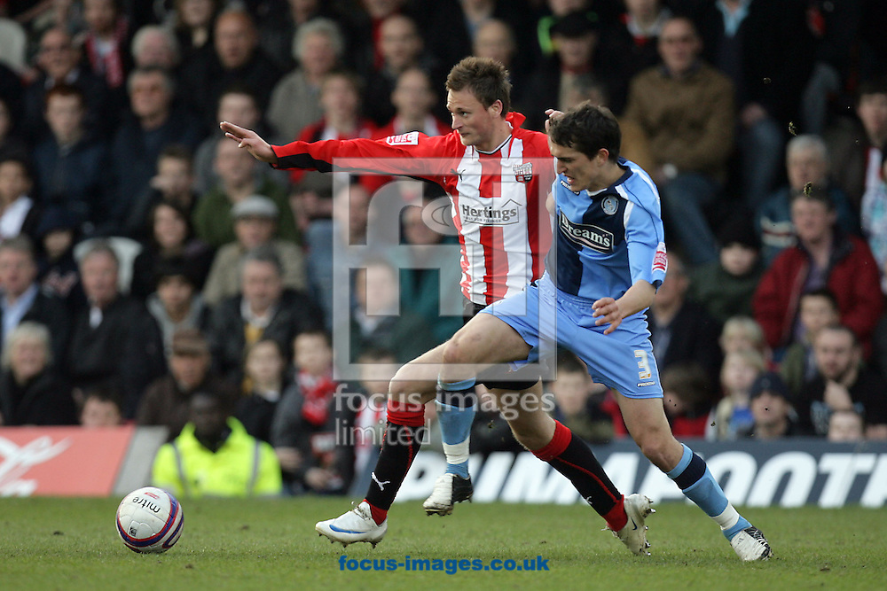 London - Saturday, March 14th, 2009: Sam Williams (L) of Brentford and Craig Woodman of Wycombe Wanderers during the Coca Cola League Two match at Griffin Park, London. (Pic by Mark Chapman/Focus Images)