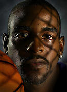 Chris Webber with a shadow of a basketball net over his face during Kings Media Day October 1, 2004.