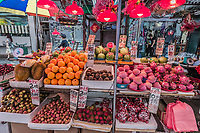 Kowloon, Hong Kong- June 9, 2014: Mong Kok tropical fruit market stall